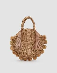 9e03360e5088 Loeffler Randall Straw Circle Tote in Natural. Woven raffia tote from  Loeffler Randall in Natural. Two top handles with large leather tassels.