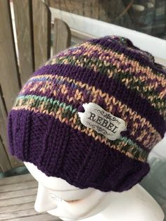 Rebel – Message Hat – Hand knit – Plum, green tan print