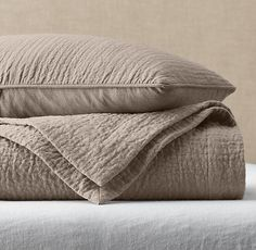 RH's Vintage-Washed Linen Channel-Quilted Coverlet & Sham:FREE SHIPPINGOur linen bedding is tailored with rows of channel stitching for understated style and a lightly quilted finish. Pre-washing gives the linen a relaxed, lived-in softness, and the touch only gets softer with each laundering.