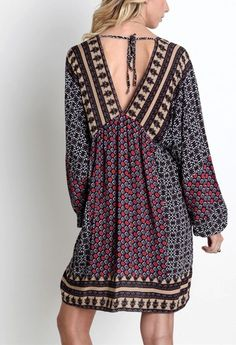 65% Cotton, 35% Polyester. This Boho chic dress is fantastic. Awesome Hippie chic print .. loose fit, bohemian delight. Slightly sheer Tunic style with long sleeves, V neck and a tie back closure, as