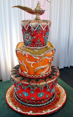 Moroccan. 3 tier wedding cake decorated in a Moroccan style. In all fairness we like to call this design the RoseBraun. :) All edible and the customer provided the lamp to go on top. By Cory of Rosebud Cakes.