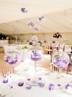 Fish bowls centre piece / flowers. Purple wedding. Orchids