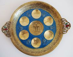 a beautiful Passover plate for Seder. the plate is made of brass and the expert craftsmanship is evident. the plate depicts a scene from the wailing wall in Jerusalem. the beautiful colors makes this Seder plate truly special.