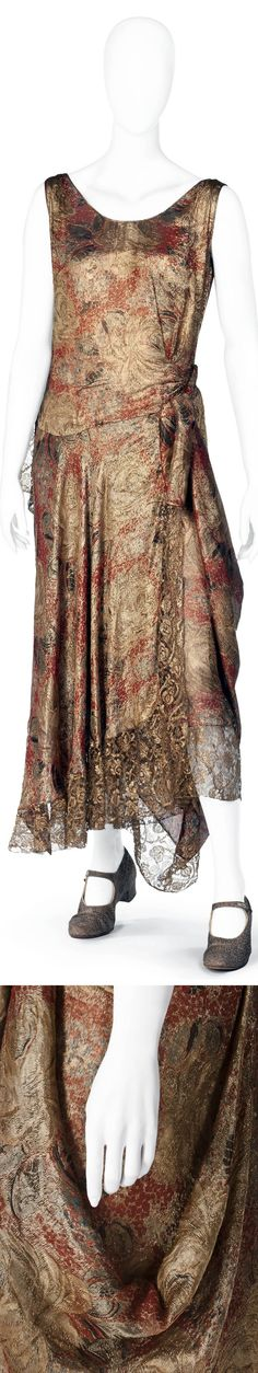 1920 full-length gown of gold lamé and silk brocade with red, black, and blue elements. Sleeveless, straight, bell-shaped skirt and round neckline. Asymmetric cut at waist, skirt open and wrapped. Lined with salmon pink silk petticoat. Hallwyl Museum via Wikimedia Commons.