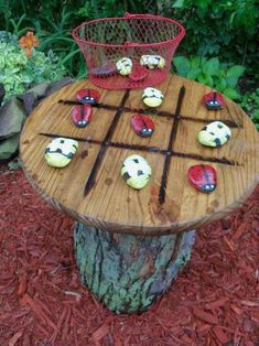 Make your own tic-tac-toe table with stones and a tree stump to provide a fun and natural place for you and your kids to play.
