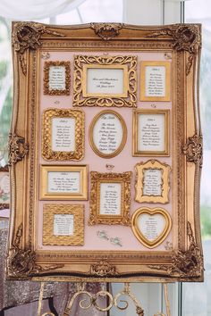 A stunning seating arrangement display! Not only is this functional for showing the guests where to sit, it would also make beautiful decor! An elegant large gold frame, a pink background, and lots of smaller gold frames holding the seating chart.