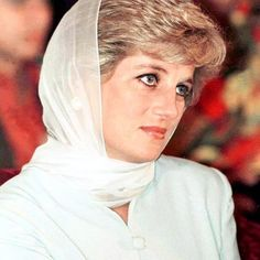 21 February 1996: Princess Diana covers her head with a scarf during a fund raising party in aid of Shaukat Khanum Cancer Hospital in Lahore, Pakistan .