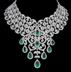 Stunning collar-style necklace features 30 carats of round brilliant diamonds and 4 carats of rose-cut diamonds along with 12.6 carats of emeralds set in 18 Karat White Gold. - India's leading luxury jeweler, Bapalal Keshavlal