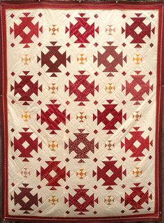 """""""Cheddar Cheese and Wine, Please!"""" quilt pattern and kit by Karen O'Connor of Red Rooster Quilts. The finished churn dash blocks are 8 1/2"""" and the cheddar blocks are 3""""."""