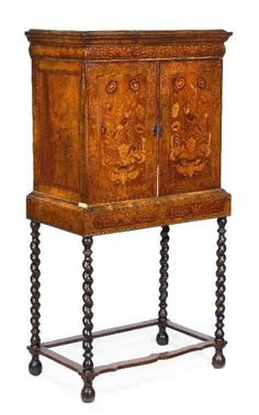 A William Mary walnut and marquetry cabinet on s : Lot 157