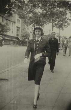 Helene Lawrence walking on sidewalk, circa 1945 - The Betty H. Carter Women Veterans Historical Project -UNCG University Archives