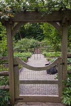 Raised Bed Vegetable  Herbs Garden Fenced Gate, stone pebble walkway, protection from pest animals, fruit trees at rear