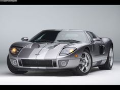 Ford GT! Yes I will own her one day! Sexiest car ever! Can't you see me in this!? :)