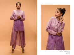 A bold lilac long short high collared top with straight fitted pants by…