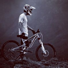 Downhill mountain bike rider standing with his downhill bike before a run down a track. http://www.tresna.co.uk