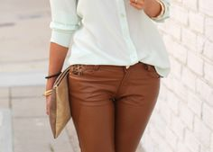 Dark tan leather pants w/ white top and nude clutch