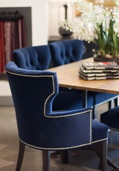 Crushed velvet royal blue dining chairs and wood table