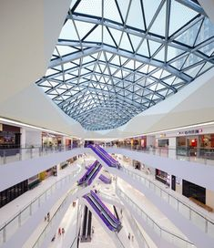 Spark incorporates giant screens into faceted shopping centre facade | 2015 Decor