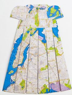 French artist Elisabeth Lecourt has taken the beauty and concept of a map one step further with Les Robes Géographiques.She folds paper maps and attaches them together to create these variations on children's clothing. The garb is not meant to be worn, but rather to be observed as an intimate piece of art, hanging on the wall.