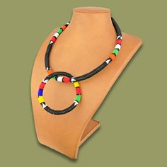 African beaded necklace handmade in by the Zulu beaders from South Africa.  African Beaded Necklaces handmade by the rural earthafricacurio.com #africanbeadednecklaces #africannecklaces #necklaces #beadednecklaces #africanbeadednecklacessouthafrica #traditionalbeadednecklaces #handmadeafricannecklaces #ethnicnecklaces #ethnicbeadednecklaces #zulubeadednecklaces #traditionalbeadednecklaces #traditionalafricanbeadednecklaces #southafrica #africanbeadwork #southafricanbeadwork Beaded Necklaces, Handmade Necklaces, Beaded Christmas Decorations, African Crafts, African Beads, Zulu, Flower Necklace, Beadwork, South Africa