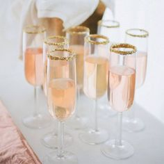 We love these gold sugar coated champagne flutes An elegant and sophisticated way to serve your guests their welcome drink www.wed2b.co.uk
