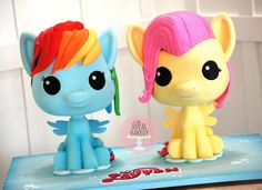 My Little Pony Cakes -Rainbow Dash is a Rainbow Cake filled with lie Vanilla Swiss Meringue Buttercream. Fluttershy is a Yellow Butter Cake filled with Bright Pink Strawberry Swiss Meringue Buttercream by Royal Bakery