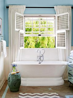 This tub provides a sunny spot to relax and unwind! More cottage bathroom ideas: http://www.bhg.com/bathroom/decorating/cottage/country-bathroom-design-ideas/?socsrc=bhgpin061513window=20