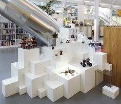 Completed by designers Rosan Bosch and Rune Fjord in 2010, the open-plan office in Billund incorporates block-like display stands, model-building tables and a library of Lego pieces.