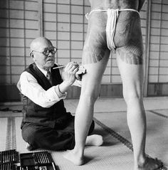 A Japanese tattoo artist works on a   Yakuza gang member, Tokyo 1946. By Horace Bristol