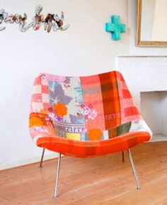 I love this vintage chair with a new life- by a patchwork re-upholstery with vintage blankets, crochet and embroidery. You can use this technique with anything you want to refurbish. DIY project: patchwork chair | Design*Sponge |