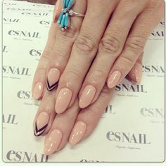 Nude with black chevron/arrow accent. & Rounded/squared nail must have