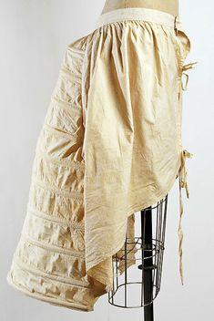 Bustle Date: 1870s Culture: American Medium: cotton, whalebone Dimensions: Length at CB: 28 in. (71.1 cm) Credit Line: Gift of Mrs. Clyde R. Keith, 1953 Accession Number: C.I.53.51.14