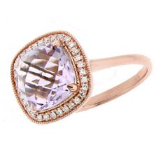 Striking 14k rose gold ring with a 3.14ct faceted cushion cut rose amethyst framed with diamonds (.10cts total)