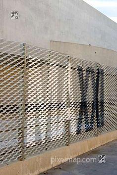 MAXXI painted on expanded metal fence-Zaha Hadid Museum Rome Metal Facade, Metal Mesh Screen, Metal Panels, Metal Signage, Wayfinding Signage, Signage Design, Expanded Metal Mesh, Environmental Graphic Design, Perforated Metal