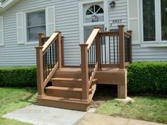 small back deck with steps porch shown timbertech twinfinish decking in cedar - Front Porch Designs For Mobile Homes