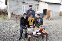 Credit: David Levene/David Levene Mirza Bakhishov,  47, and his family pose with a week's worth of food outside their home in Shahveller village. Mirza, 47, was born and bred in this village, in this house. He has been engaged in agriculture and animal husbandry all his life. He and his wife, Zarkhara, 37, and two sons, Khasay, 18 and Elchin, 15, own a small amount of land. Zarkhara produces 1 hectare of alfalfa, which he uses for his animals. He also cultivates a small area of cotton and…