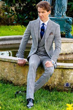 Italienisch graue und blaue Anzug mit abfallendes Revers, 2 Steinnüsse-Knöpfe, Ticket Pocket und Seitenschlitze. Schottenmuster Wollmischung Stoff. Hochzeitsanzug 1804 Kollektion Gentleman Ottavio Nuccio Gala.