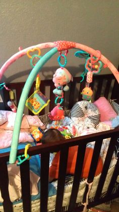made October her own Mobile with left over toys from her tummy time stuff