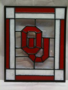"Stained Glass Oklahoma University Sooners - OU - Faux    Are you ready for some football!!!! If you're a big OU fan then you'll want to add this to your collection to show your school and team spirit. This is a plexiglass panel with the OU logo painted on it, framed in a clear transparent frame, with a black border. This panel has been framed in a clear transparent frame so it can hang or stand near a window or any light to allow the rays to shine through and dazzle everyone.     Total size 8"" x 10"" (without the frame). Frame included with purchase.    Thanks for stopping by and have a groovy day! Boomer Sooner!!!     $19.00"