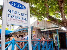 Siesta Key Oyster Bar is a favorite for locals, sit outside, listen to live music, and enjoy fresh seafood and terrific Happy Hour specials! Photo by Debi Pittman Wilkey.