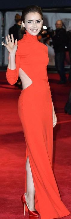 Forget the red carpet, it's all about that red dress. Lily Collins looked immaculate in her tight crimson dress at the Love, Rosie premiere on Monday night. Phil Collins, Lily Collins Style, Brunette Models, Coral, Red Carpet Looks, Red Carpet Fashion, Dream Dress, Lady In Red, Celebrity Style