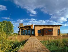 A river runs through it, but this modern Wyoming home is just as notable for its inventive architectural take on the log cabin archetype