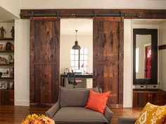 Tall sliding barn doors set off an office alcove while also serving as a handsome focal point in the living room, whether open or closed.