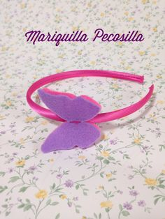 Diadema con mariposas de fieltro en rosa y morado