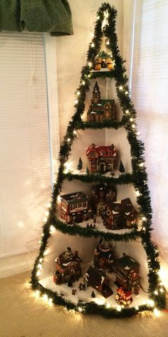 Christmas Village Display Tutorial Wooden Christmas Tree image 1 Do this but display nativity scenes. Christmas Tree Village Display, Corner Christmas Tree, Christmas Tree Images, Pretty Christmas Trees, Creative Christmas Trees, Christmas Diy, Beautiful Christmas, Christmas Villages, White Christmas