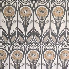 Charles Rennie Mackintosh Fabric, mustard and grey roses with stylised green stems on a cream background.