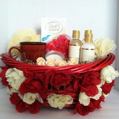 (Spa Gift Basket) Give someone the gift of relaxation and personal care with spa gift baskets. Shower Gel Body Lotion Bubble Bath Soap Rose Petals Cup Candle Sponge Lindt Lindor Irresistibly Smooth White Chocolate Truffle
