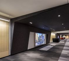 LEMAYMICHAUD | Quebec | Conference Hall | Architecture | Design | Seating | Carpet | Black | Gray | Red | White | Concrete | Signage | Screen