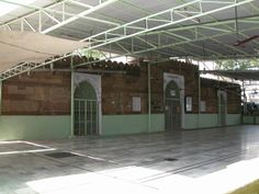 Haibatkhan's Masjid (Ahmedabad).  Haibat Khan's Masjid is situated at Lat. 230 01' N; Long. 720 35' E. This mosque is believed to have been built around A.D. 1424 by Haibat Khan, who was a leading noble man at the court of Ahmed Shah. Its minarets are small and central dome is richly carved. The pillars are from various Hindu temples. The entrance through an ornate porch leads to the sanctuary which is pierced by three pointed archways.
