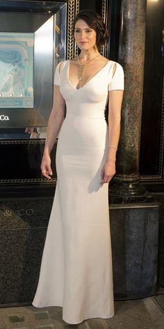Gemma Arterton in a red carpet look wearing a Victoria Beckham dress.